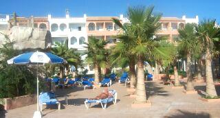 Sun-bathing amongst the palms at hotel Vera Playa Club