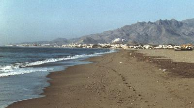 The beach at Vera Playa, early morning, looking south towards Puerto Rey, Garrucha and Mojacar