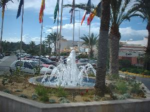 bars, restaurants, supermarket and shops outside the main entrance of the Vera Playa Club Hotel