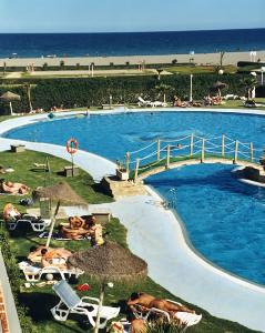 The beautiful outdoor pool at Vera Natura and sea beyond