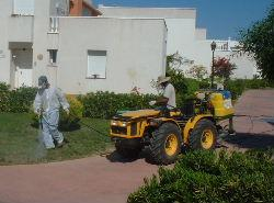 Spraying against mosquitoes at the Bahia de Vera urbanizacion, June 2004 - click on photo for larger version  - photo copyright veraplaya.info